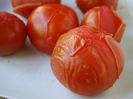 Tomatoes, after 10-15 seconds in boiling water: ready to undress! // FoodNouveau.com