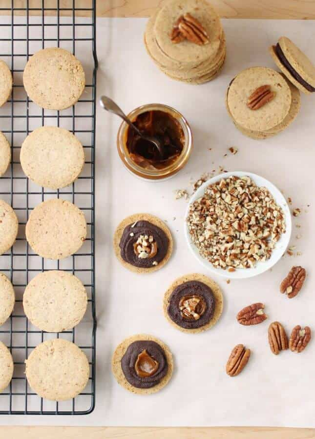Pecan Shortbread Cookies with a Dark Chocolate and Caramel Filling // FoodNouveau.com