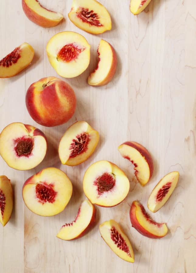 Fresh peaches that will be used to make an aromatic Bourbon Peach Crisp. // FoodNouveau.com