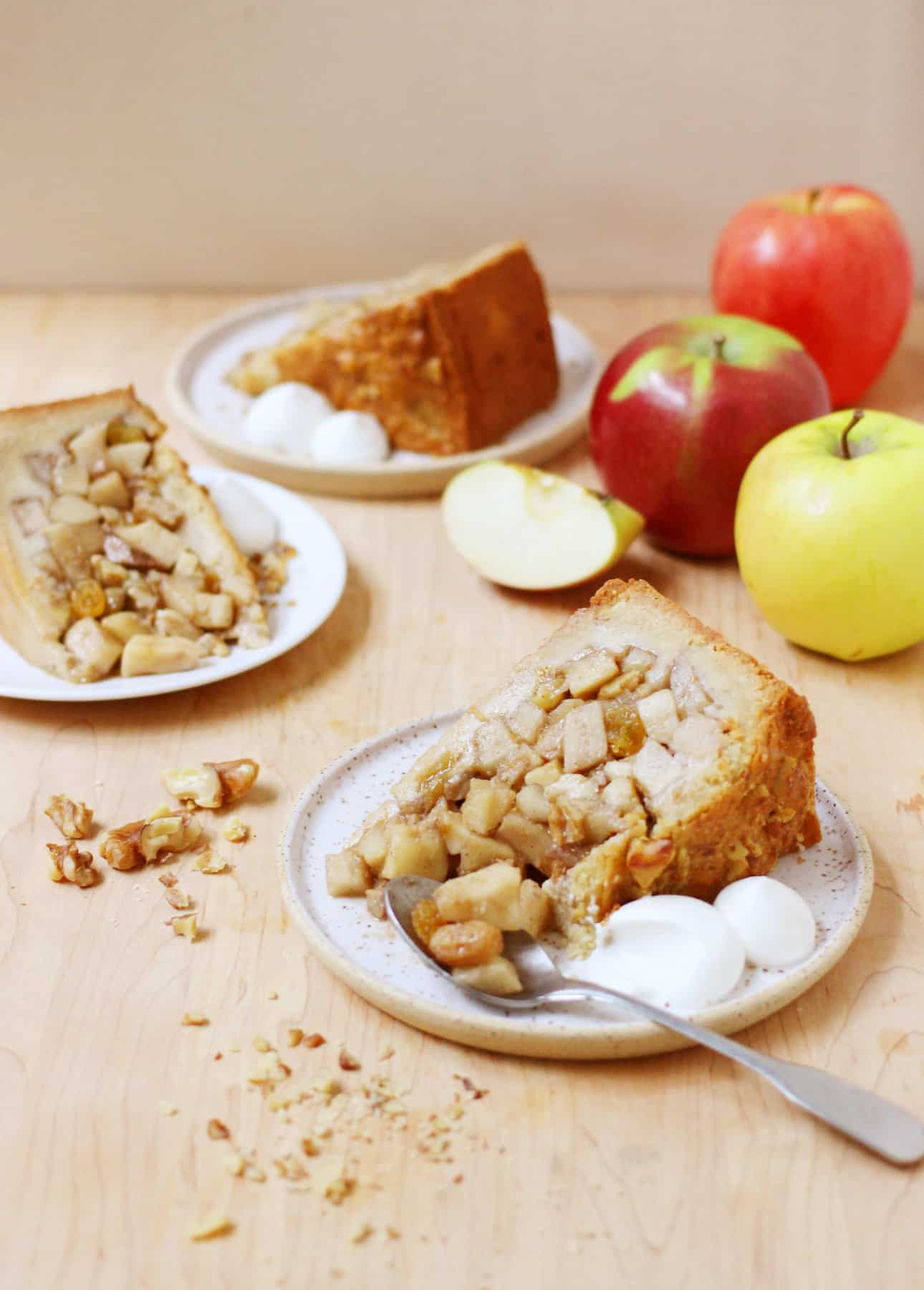 Slices of Deep-Dish Dutch Apple Pie, Served with Whipped Cream // FoodNouveau.com